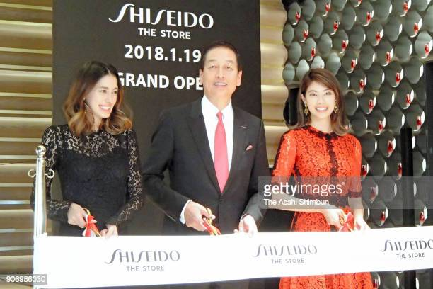 Shiseido President Masahiko Uotani and models Izumi Mori and Hikari Mori attend the 'Shiseido The Store' opening ceremony on January 18 2018 in Tokyo...
