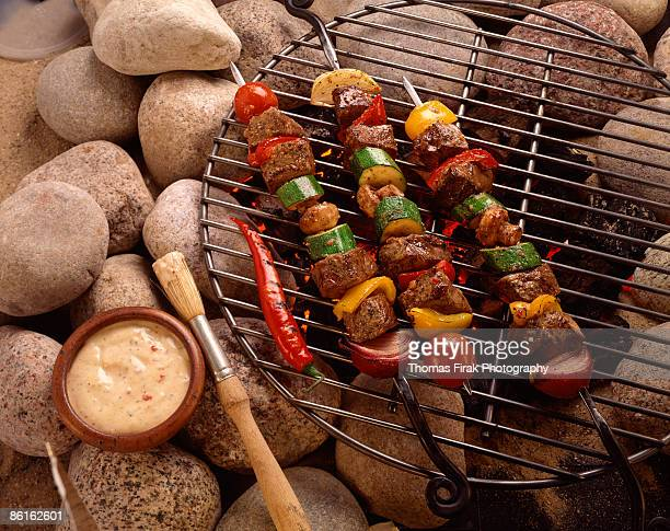 shish kabobs on grill -  firak stock pictures, royalty-free photos & images