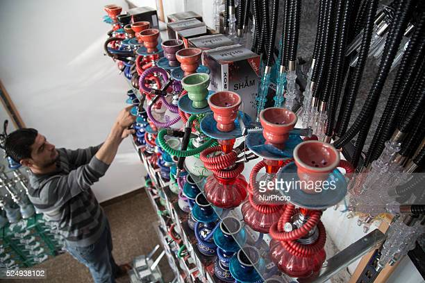 Shisha and tobacco shop in Gaza city there are different forms colors and prices of shisha shisha a water pipe used for smoking purposes originating...
