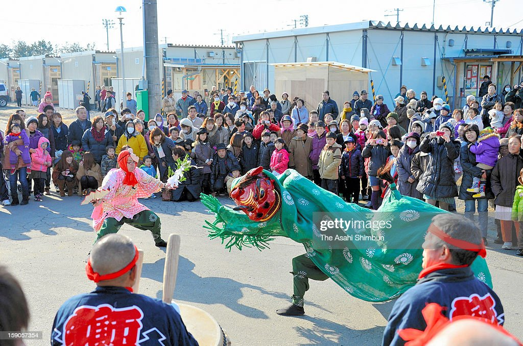 Shishimai lion dance is performed outside a temporary housing as new year celebration on January 2, 2013 in Higashimatsushima, Miyagi, Japan.