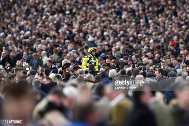 Shishkin ridden by Nico de Boinville celebrates after winning the Sky Bet Supreme Novices' Hurdle at Cheltenham Racecourse on March 10, 2020 in...