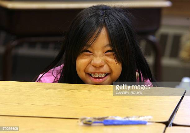 A students smiles from behind her desk at the school in Shishmaref Alaska 27 September 2006 The village home of Inupiat Eskimos is located 20 miles...