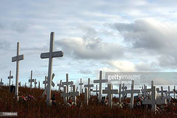 Crosses stand 26 September 2006 at the cemetery in Shishmaref Alaska The village home of Inupiat Eskimos is located some 600 miles northwest of...