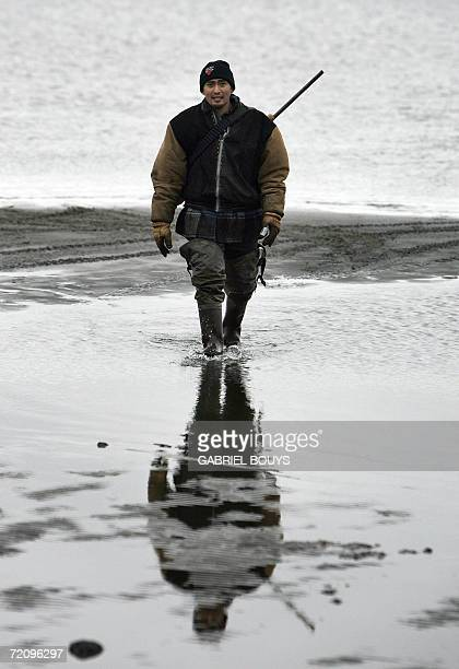 Eskimo hunter Johnny Jr Weyiouamma from Shishmaref Alaska returns without a catch following a day on his boat hunting seals 26 September 2006 The...