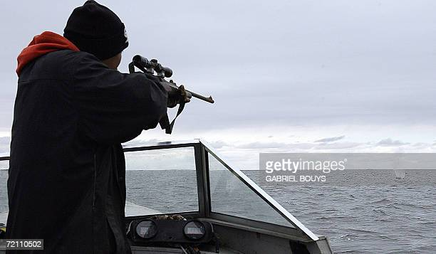Eskimo hunter Johnny Jr Weyiouamma from Shishmaref Alaska shoots as he tries to hunt a seal 26 September 2006 The village home of Inupiat Eskimos is...