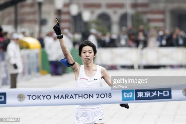 Shitara Yuta of Japan crosses the finish line to take the second place in the men's race of the Tokyo Marathon 2018 in Tokyo Japan 25 February 2018...