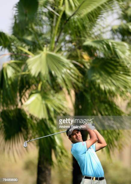 Shiv Kapur of India hits his second shot on the fifth hole during the final round of the Dubai Desert Classic on the Majilis Course at the Emirates...