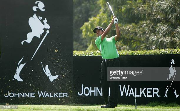 Shiv Kapur of India tees off on the eighth hole during the final round of the 2008 Johnnie Walker Classic held at The DLF Golf and Country Club on...