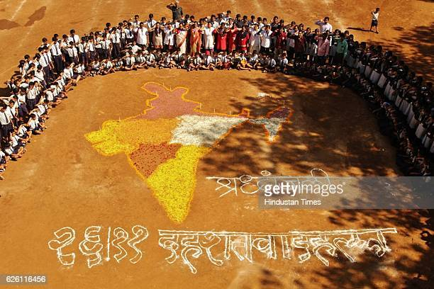 Shiv Samarth School students pay tribute to victims of 26/11 Mumbai Terror attacks at school ground Thane on November 26 2016 in Mumbai India India...