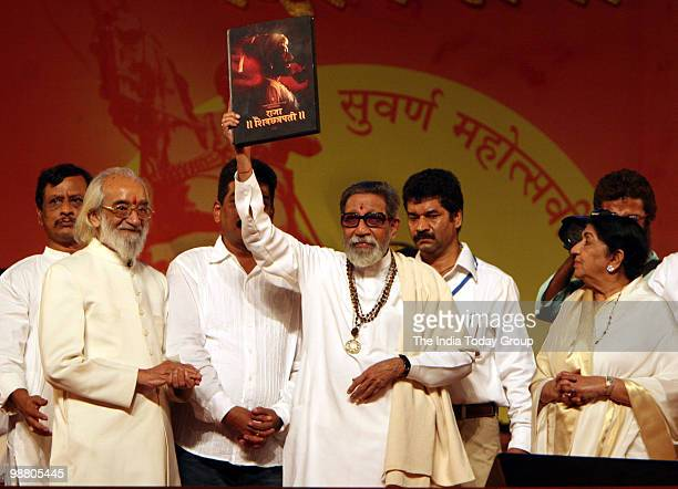 Shiv Sena chief Bal Thackeray launches a photography book by his son Uddhav Thackeray with the historian Babasheb Purandare and Lata Mangeshkar...