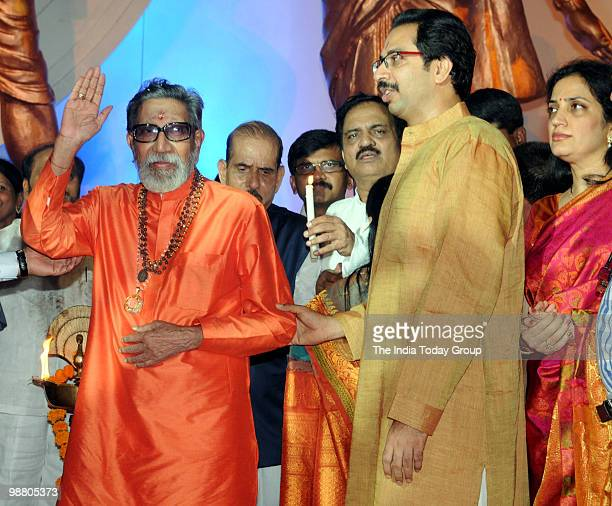 Shiv Sena chief Bal Thackeray with his son and Sena's executive president Uddhav Thackeray interact with media during the inauguration of the...