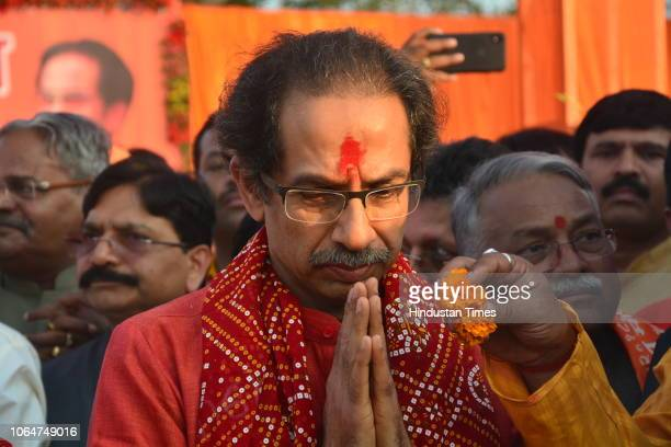 Shiv Sena chief Uddhav Thackeray performs pooja before attending the programme at Laxman Ghat on November 24 2018 in Ayodhya India Shiv Sena which...