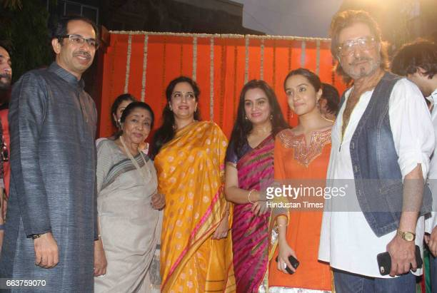 Shiv Sena Chief Uddhav Thackeray singer Asha Bhosale Rashmi Thackeray actors Padmini Kolhapure Shraddha Kapoor and Shakti Kapoor during the opening...