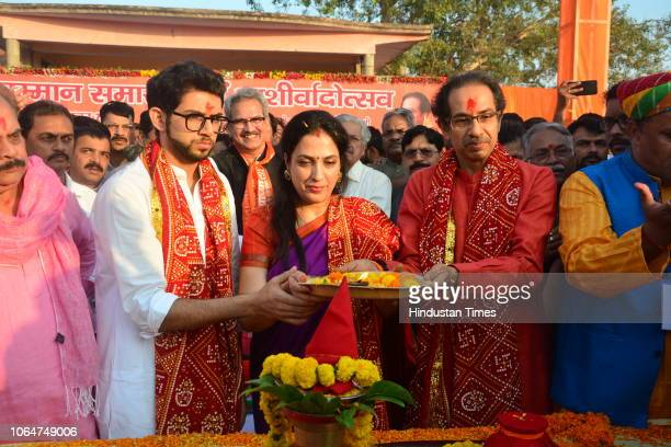 Shiv Sena Chief Uddhav Thackeray with his wife Rashmi and son Aditya during a programme at Laxman Ghat on November 24 2018 in Ayodhya India Shiv Sena...