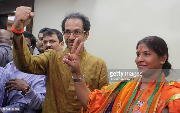 Shiv Sena President Uddhav Thackeray poses for a photo with party candidate Trupti Sawant who won the bypoll on April 15 2015 in Mumbai India Shiv...