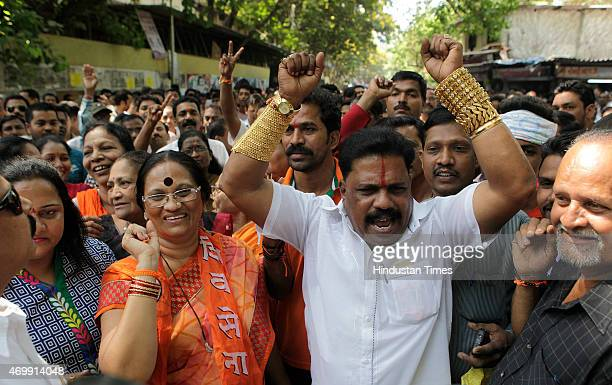 Shiv Sena workers celebrating to mark parties victory in the Bandra bypolls on April 15 2015 in Mumbai India Shiv Sena candidate Trupti Sawant widow...