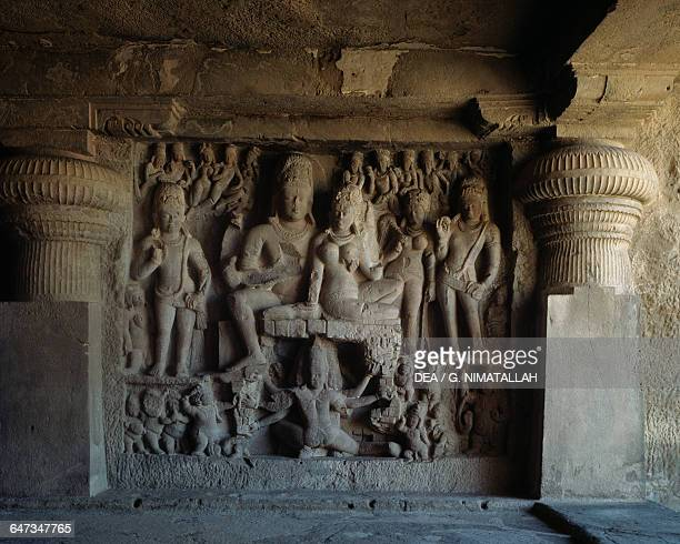 Shiva and Parvati seated on mount Kailash while Ravana tries to lift it relief from Dhumar Lena Ellora Caves Maharashtra India 6th8th century