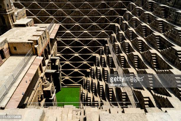 shiva carving at ancient stepwell chand baori biggest stepwell near jaipur rajasthan india - udaipur stock pictures, royalty-free photos & images