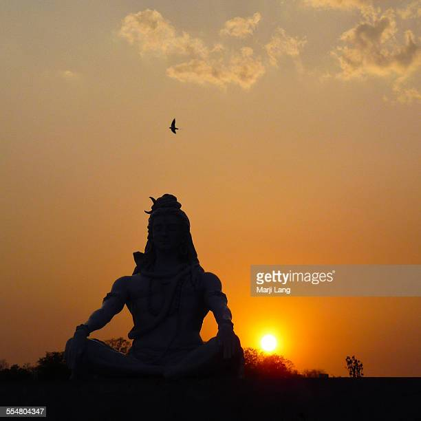 shiva statue at sunset in rishikesh - shiva stock pictures, royalty-free photos & images