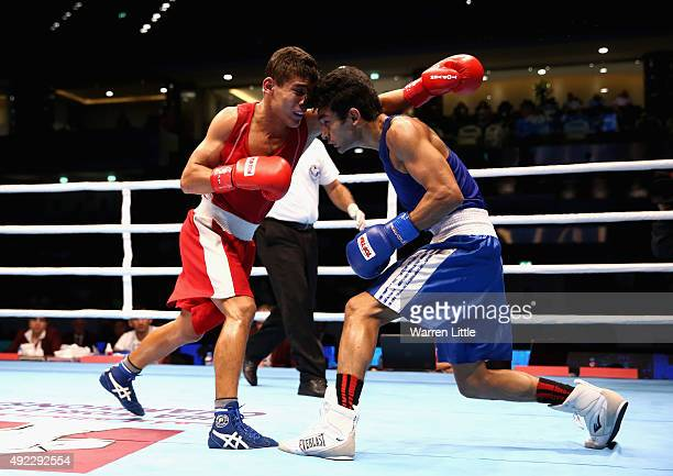 Shiva Thapa of India and Murodjon Akhmadaliev of Uzbekistan fight in the Men's Bantam during the semi finals of the AIBA World Boxing Championships...