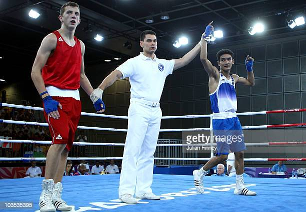 Shiva Thapa of India celebrates defeating Zack Davies of Great Britain in the Bantam 54kg match during the boxing at the convention centre on August...