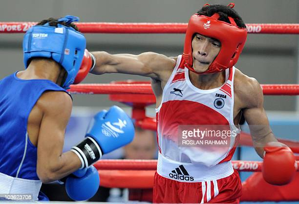 Shiva Thapa of India fights against Robeisy Eloy Ramirez of Cuba during the Bantam 54kg gold medal bout at the 2010 Youth Olympic Games in Singapore...