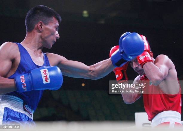 Shiva Thapa of India in action against Dorji Wangdi of Bhutan during the 1st India Open international boxing tournament in New Delhi