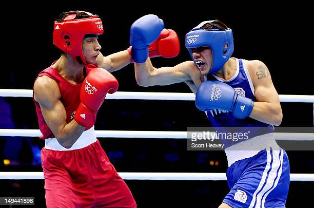 Shiva Thapa of India in action with Oscar Valdez Fierro of Mexico during their Men's Bantam Weight bout on Day 1 of the London 2012 Olympic Games at...