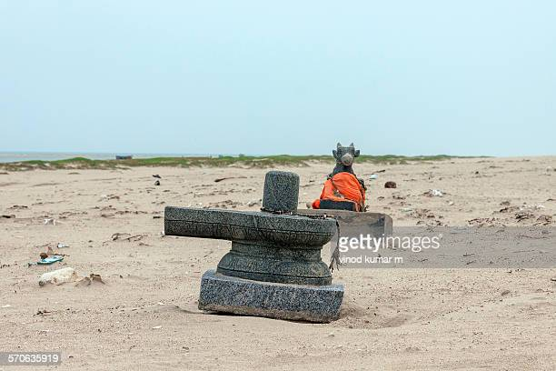Shivalinga and Nandikeshvar statue on beach