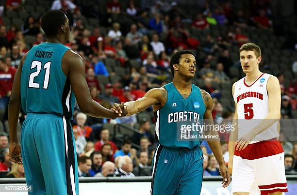 Shivaughn Wiggins and Tristian Curtis of the Coastal Carolina Chanticleers console each other after their 86 to 72 loss to the Wisconsin Badgers...