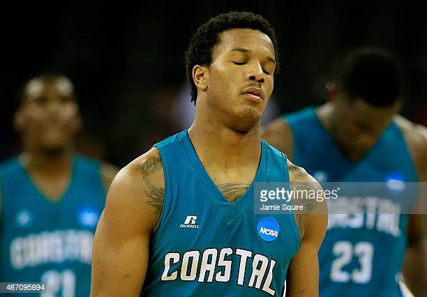 Shivaughn Wiggins of the Coastal Carolina Chanticleers reacts after their 86 to 72 loss to the Wisconsin Badgers during the second round of the 2015...