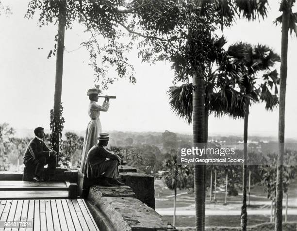 the Pilgrim's Rest a European traveller looks out with a telescope Myanmar 1900