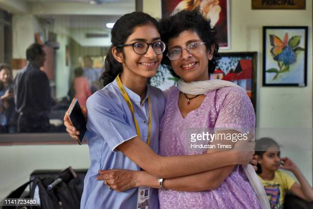 Shivika Dudani the Delhi topper in the class X CBSE results celebrates with her mother at Amity International School Pushp Vihar on May 6 2019 in New...