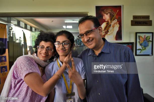 Shivika Dudani the Delhi topper in the class X CBSE results celebrates with her parents at Amity International School Pushp Vihar on May 6 2019 in...