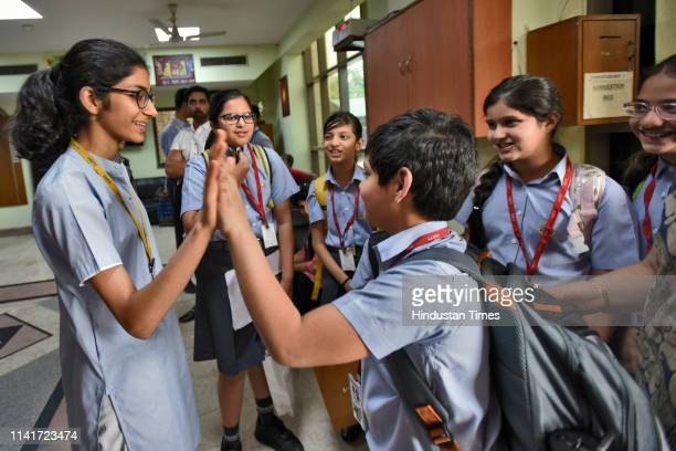 Shivika Dudani the Delhi topper in the class X CBSE results celebrates with other students at Amity International School Pushp Vihar on May 6 2019 in...