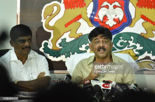 Shivkumar minister of Irrigation and Medical education in Karnataka government along with his brother D K Suresh during a press conference after ED...