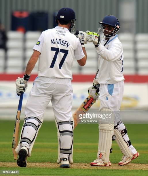 Shivnarine Chanderpaul of Derbyshire celebrates reaching his 100 with Wayne Madsen of Derbyshire during the LV County Championship Division One match...