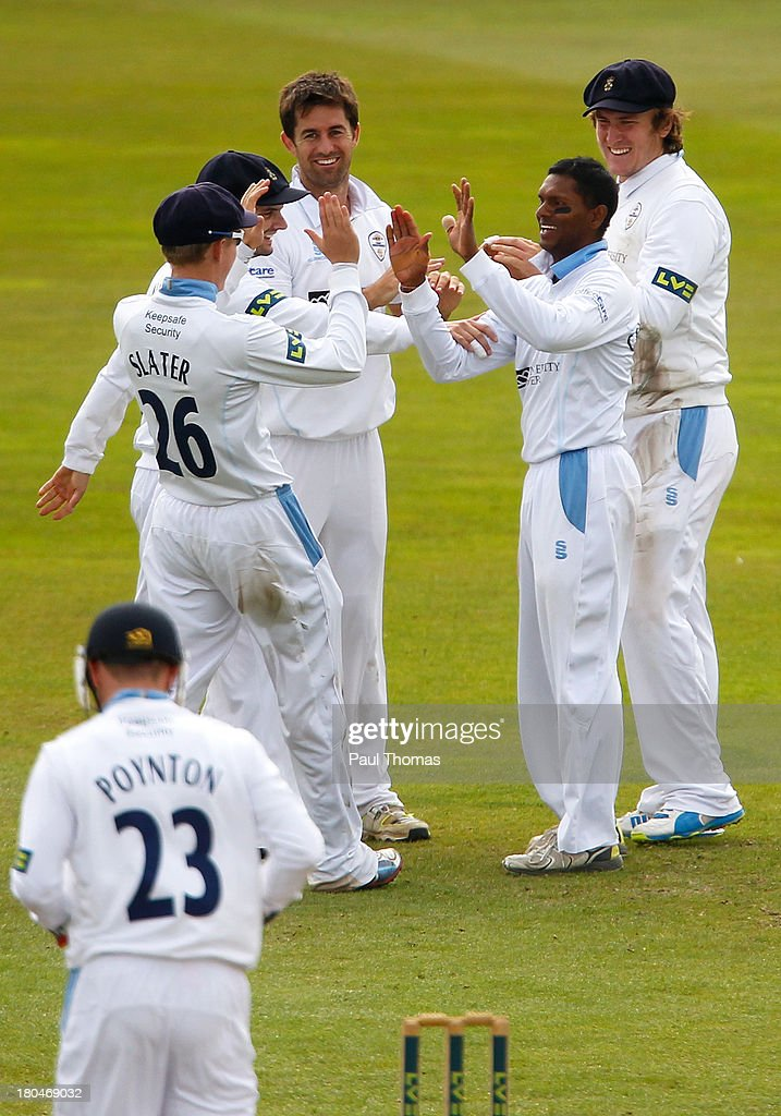 Shivnarine Chanderpaul (2nd R) of Derbyshire celebrates with team mates after taking the wicket of Durham's Scott Borthwick (not pictured) during the LV County Championship match between Derbyshire and Durham at The County Ground on September 13, 2013 in Derby, England.