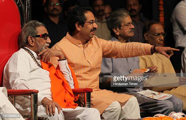 Shivsena chief Balasaheb Thackeray and executive president Uddhav Thackeray attend the party workers meeting before upcoming civic elections at...