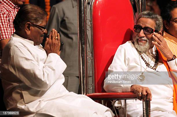 Shivsena chief Balasaheb Thackeray chats with Datta Bhai Nalwade during the party workers meeting before upcoming civic elections at Bandra on...