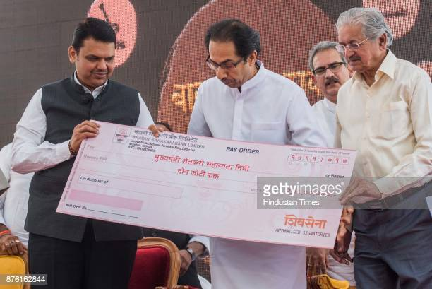 Shivsena chief Uddav Thackeray handover the cheque of RS 2 crore to Maharashtra chief minister Devendra Fadnavis for the development of Farmers...