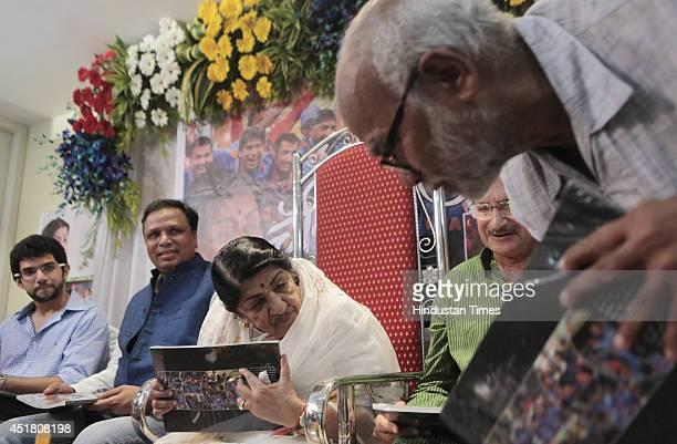 Shivsena leader Aditya Thackray Ashish Shelar Veteran singer Lata Mangeshkar and former cricketer Ajit Wadekar during the launch of book Champion...