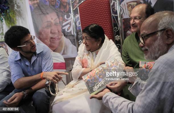 Shivsena leader Aditya Thackray Veteran singer Lata Mangeshkar and former cricketer Ajit Wadekar during the launch of book Champion authored by Photo...