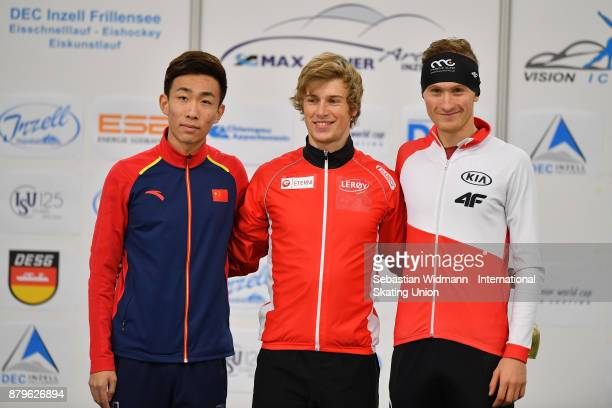 Shiwei Wang of China Runar Njatun Kroyer of Norway and Marcin Bachanek of Poland pose during the medal ceremony of the Men mass start the ISU Neo...
