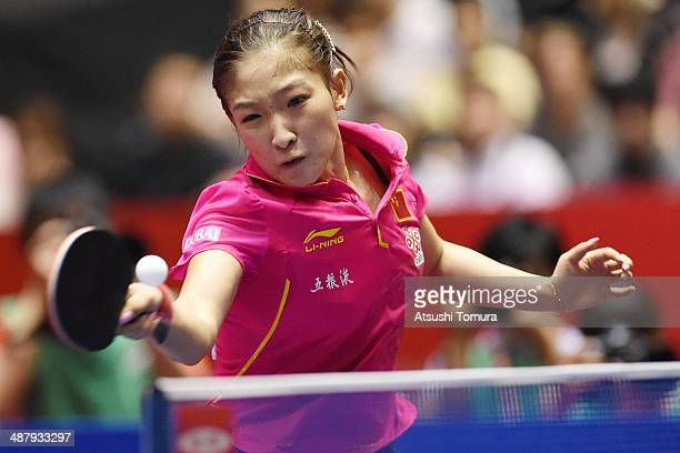 Shiwen Liu of China plays a forehand against Myong Sun Ri of North Korea during day six of the 2014 World Team Table Tennis Championships at Yoyogi...