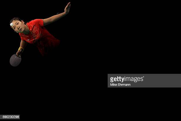 Shiwen Liu of China plays a match against Petrissa Solja of Germany in the Women's Team Gold Medal Team Match between China and Germany on Day 11 of...