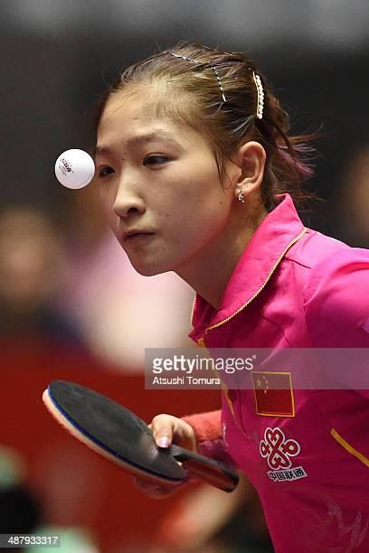 Shiwen Liu of China serves against Myong Sun Ri of North Korea during day six of the 2014 World Team Table Tennis Championships at Yoyogi National...