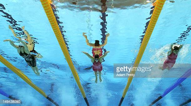 Shiwen Ye of China Katinka Hosszu of Hungary and Zsuzsanna Jakabos of Hungary swis breaststroke as they compete in heat three of the Women's 400m...
