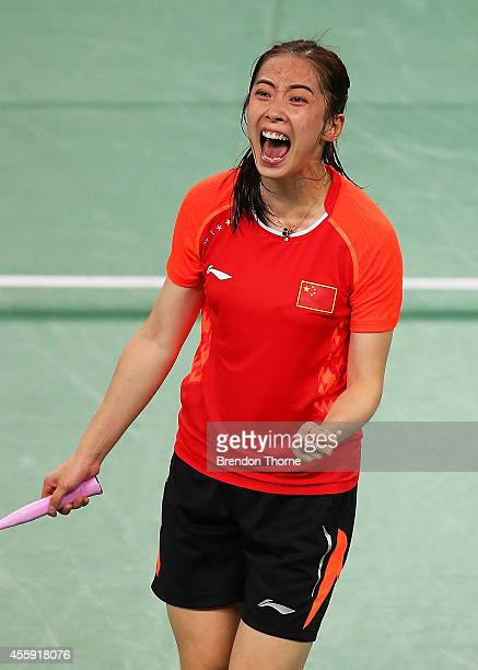 Shixian Wang of China celebrates match point to claim the Gold Medal for China in the Women's gold medal match during day three of the 2014 Asian...