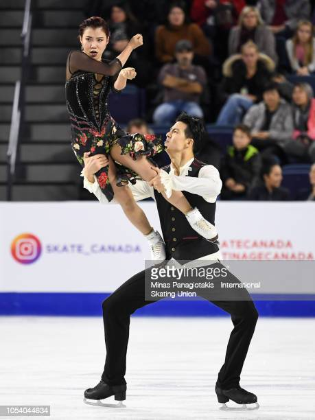 Shiyue Wang and Xinyu Liu of China compete on day one during the ISU Grand Prix of Figure Skating Skate Canada International at Place Bell on October...